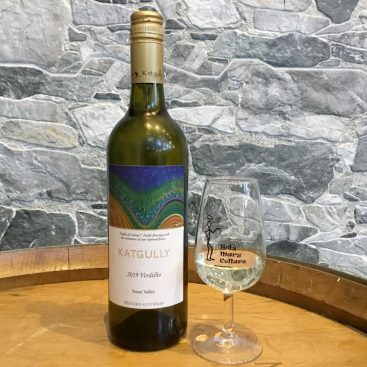 A photo of a Katgully Wines bottle and Holy Mary Cellars glass